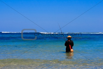 Asian fisherman in sea