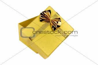 Opened gold shining gift box isolated on white.
