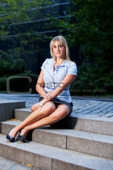 business woman sitting outdoors
