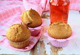 homemade chocolate muffins on a pink background