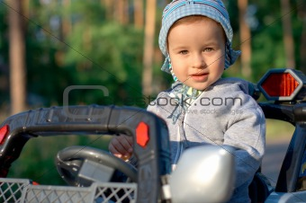 Baby at the toy car