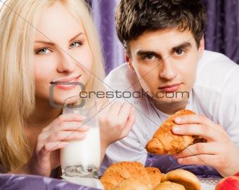 Couple breakfast bed milk moustache