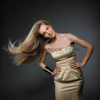 Portrait of woman with fluttering hair