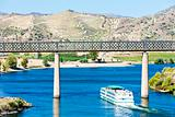 railway viaduct and cruise ship in Pocinho, Douro Valley, Portugal