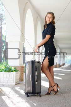 Beautiful girl with luggage