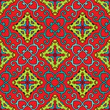 Baroque pattern with swirls on a bright red background