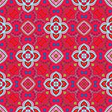 Floral pattern with swirls on a bright red background