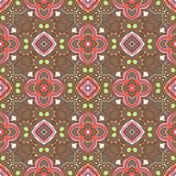 Floral pattern with swirls on a brown background