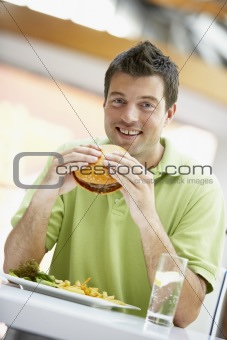 Man Eating Lunch At A Cafe