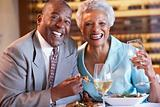 Senior Couple Having Dinner Together At A Restaurant
