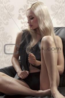 beautiful girl sitting on a sofa