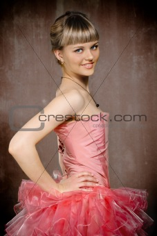 Portrait of the beauty young blond girl near the wall