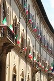 Italian flags outside of a windows