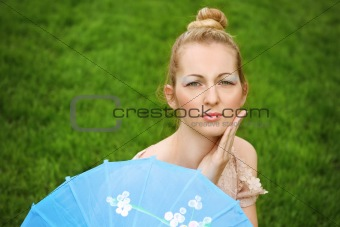 Beautiful blond girl with geisha make up