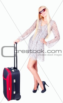 Beautiful girl with a travel bag