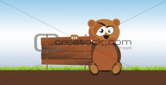 a bear holding a signboard