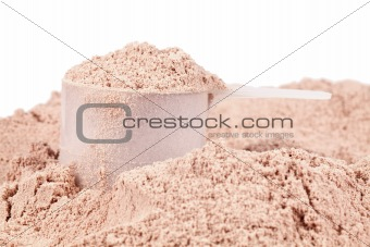 A scoop of chocolate whey isolate protein