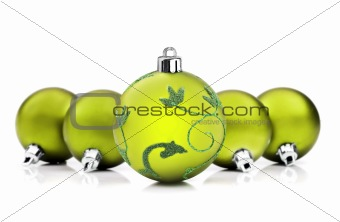 Green christmas baubles on white background with space for text