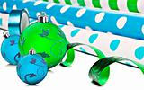 Rolls of gift wrapping paper and ribbon with blue and green christmas baubles
