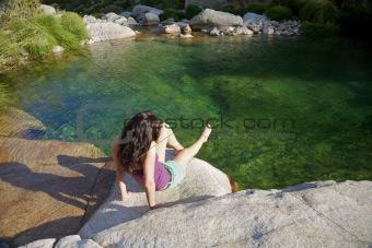 sitting next to a river at Gredos