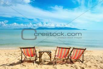 Chairs on beach near the sea