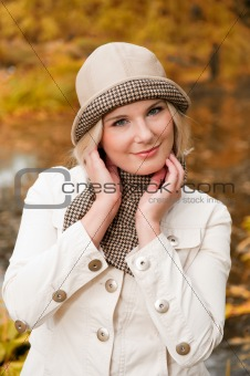 pretty autumn woman in yellow park