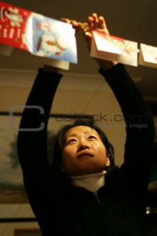 Asian woman doing christmas decoration
