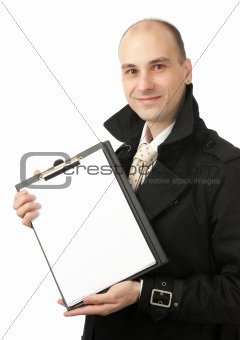 smiling businessman holds a blank paper sheet