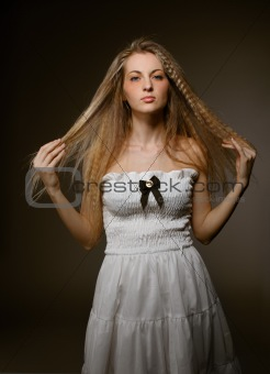 Portrait of the beauty young blond girl with make up