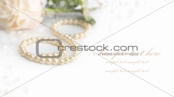Greeting card with pearls and rose