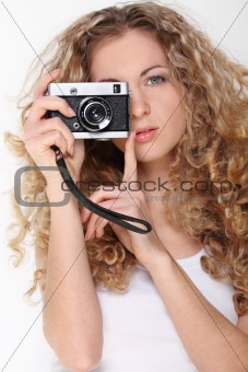 Portrait of the girl with old camera