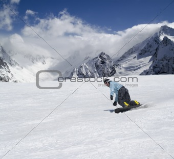 Snowboarder descends a slope