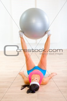 Fitness girl doing exercises with fitness ball