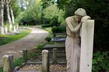 Sad statue at cemetery