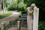 Sad statue at cemetery