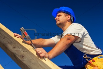 Carpenter on top of roof structure