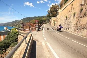 Narrow road along the sea in Italy.