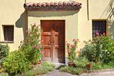 Small courtyard and wooden door in Roddi, Italy.