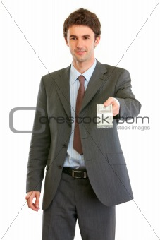 Modern businessman giving stack of dollars