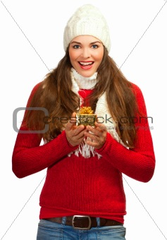 Beautiful young surprised woman holding a gift