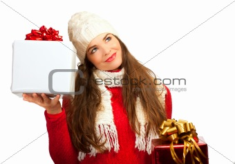 Beautiful young woman deciding what christmas present to buy.