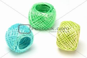 Three balls of nylon string