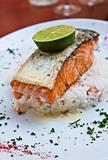 grilled salmon with sauce and lemon