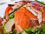 Fresh salmon salad with tomatoes