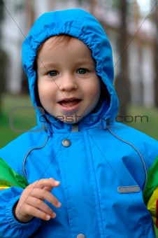 Baby in a blue raincoat