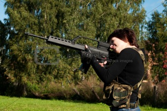 beautiful girl with a gun