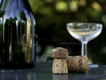 wine bottle, glass and cork in bordeaux france