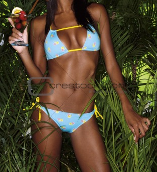 bikini girl crop with cocktail and tropical plants