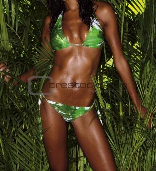 green bikini girl crop with tropical plants