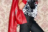 fashion model detail posing with red jacket
